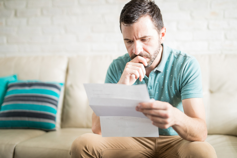 Latin Man Reading Letter